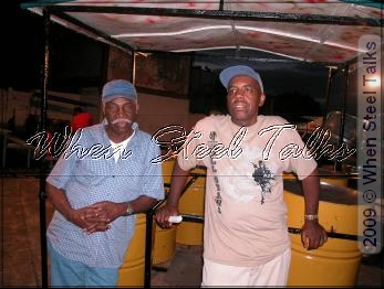 "Neville Jules and All Stars resident arranger Leon ""Smooth"" Edwards relax at the All Stars Pan yard"
