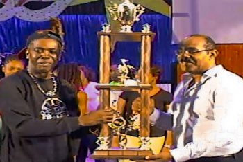 2014 Panorama champions Ebonites Steel Orchestra accept trophy from Antigua & Barbuda Prime Minister Gaston Browne