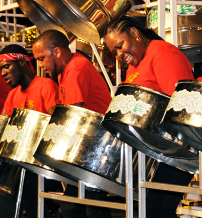 Candice Andrews-Brumant, at right, with Renegades Steel Orchestra