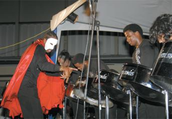 Silver Stars conductor Donnell Thomas known for his theatricality had patrons at Pan with the Saints intrigued by his costume for the band's performance of music from Phantom of the Opera