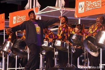 Winning Groove: Len 'Boogise' Sharpe skips along to Phase II Pan Groove's winning performance of 'Jump High' at the Panorama (large band) finals, Queen's Park Savannah, Port-of-Spain on Saturday night.