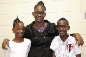 PROUD MOM: Panwoman Patrice Charles with her twin children, Deja, left, and Dejean Cain.