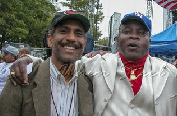Calypsonian Might Sparrow, at right, with musician Frankie McIntosh