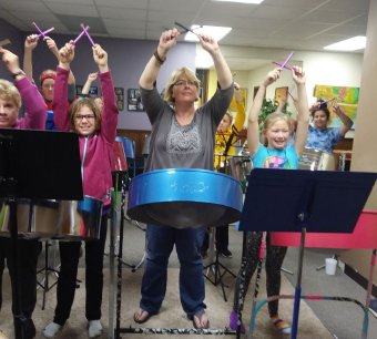 Members of the Steel Doves steel drum band rehearse. The Steel Doves are scheduled to perform at a steel drum concert at 7:30 p.m. Friday at Festival Hall along with Angel Lawrie, John Patti and other special guests.