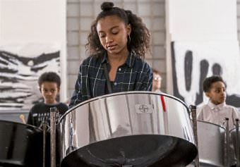 Sofia Pugliano plays the steelpan, center, along with brothers Zosha Nowe, left, and Ziah Nowe, right