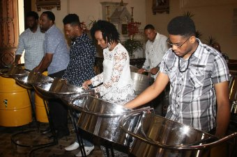 CHURCH PAN: Members of Trinidad All Stars Steel Orchestra play during their thanksgiving service yesterday at the Holy Rosary Church in Port of Spain.