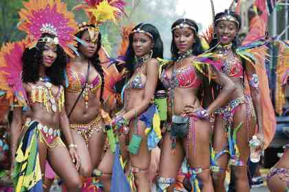 Feather-clad parade-goers strut their stuff at the West Indian Day Parade on Labor Day last year